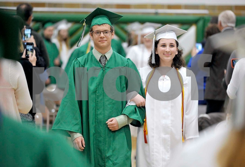 -Messenger photo by Hans Madsen<br /> <br /> Tyler McCarville, at left, along with Rachel Sherry, smile as they make their entrance during the 62nd annual commencement at St. Edmond Catholic School.