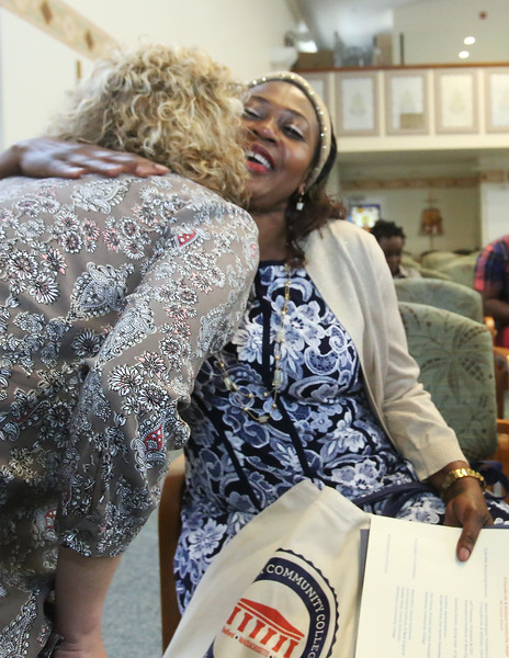 Graduation for Certified Nursing Assistants training program, co-sponsored by Lowell Adult Ed, MCC, International Institute of New England, D'Youville, and Mass DESE. Hanifah Nyabi, right, gets a hug from her work orientation teacher Sherry Spaulding of Pepperell, after ceremony. (SUN Julia Malakie)