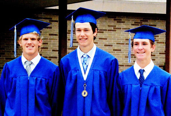 Will Fehlinger | The Herald-Tribune<br /> A special graduation ceremony was held Friday, June 1, at 10 a.m. for four regional-bound baseball players who would miss Saturday's event. Beforehand, (from left) Jayden Beal, Kyle Siefert and Sam Wade gathered in front of the school. Joseph Bohman is not pictured.