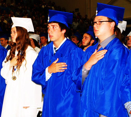 Debbie Blank | The Herald-Tribune<br /> Seniors recited the Pledge of Allegiance led by six class members who will be joining the military.