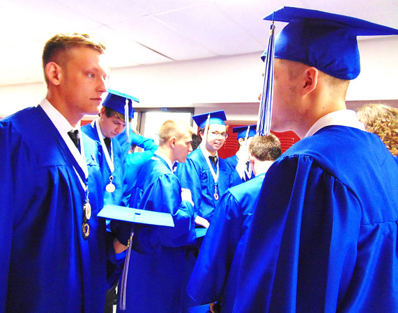 "Debbie Blank | The Herald-Tribune<br /> The 108th annual Batesville High School commencement exercises were Saturday, June 2, 2018, at 11 a.m. in the gym. Seniors waiting in classrooms and a hallway to line up exactly right. Before that, C.J. Thomas (left) and Ethan Anderson visited. Anderson looked at graduation as ""a time to move on to the next part of our lives."" For him that could be a computer science job after more education, probably at Ivy Tech Community College."