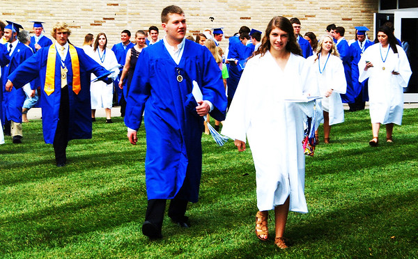 """Debbie Blank   The Herald-Tribune<br /> The newly-minted graduates pour out of BHS to meet friends and family. Valedictorian Hannah Simpson told them during the ceremony, """"Through my years here with you all, through all 720 days spent under this roof together, I can say, without a doubt, that you all have made more of an impact than you know."""""""