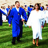"Debbie Blank | The Herald-Tribune<br /> The newly-minted graduates pour out of BHS to meet friends and family. Valedictorian Hannah Simpson told them during the ceremony, ""Through my years here with you all, through all 720 days spent under this roof together, I can say, without a doubt, that you all have made more of an impact than you know."""