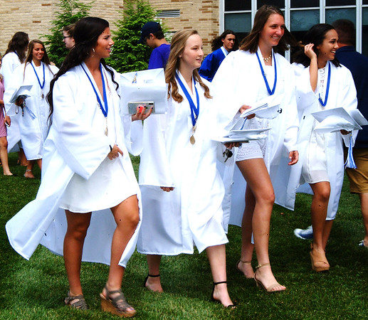 Debbie Blank | The Herald-Tribune<br /> BHS graduates hustled outside to greet well-wishers.
