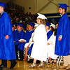 Debbie Blank | The Herald-Tribune<br /> Justin Nobbe (from left), Lila Nuhring and Nolan Obermeyer are seconds away from becoming graduates.
