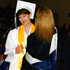 Debbie Blank | The Herald-Tribune<br /> Teacher Lisa Gausman places the valedictorian cord around Hannah Simpson's neck before she went to the podium to present her speech.