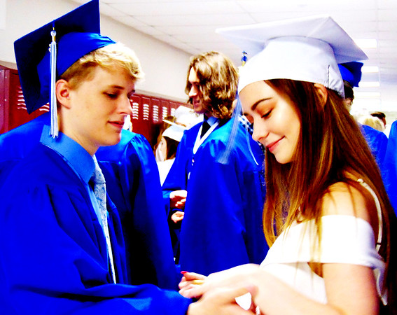 Debbie Blank | The Herald-Tribune<br /> Henry Hund and Katryna Gellenbeck share a private moment as they await commencement's start.
