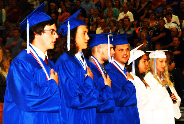 Debbie Blank | The Herald-Tribune<br /> Six members of the class who will be joining the military,  Benjamin Kurtz (from left), Henry Lipinski, Dylan Shadday,Joseph Bruns, Hope Gilbert and Ana White, led the Pledge of Allegiance. Jack Kellerman already had left for military training.