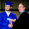 Will Fehlinger | The Herald-Tribune<br /> A special graduation ceremony was held Friday, June 1, at 10 a.m. for regional-bound baseball players Jayden Beal, Joseph Bohman, Kyle Siefert and Sam Wade, who would miss Saturday's event. Here Bohman receives his diploma from superintendent Paul Ketcham.