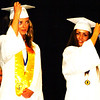 Debbie Blank | The Herald-Tribune<br /> Led by Student Council President Caroline Fitzpatrick (right) and senior class representative Sophia Brown, the fresh graduates turned their tassels.
