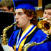 Debbie Blank | The Herald-Tribune<br /> In the gym at 10:30 a.m., Nathaniel Dunbar plays with the BHS band one last time before lining up for commencement.