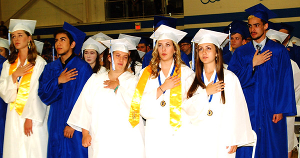 Debbie Blank | The Herald-Tribune<br /> The Pledge of Allegiance opened the 109th Batesville High School commencement Saturday, June 1, at 11 a.m. in the gym.