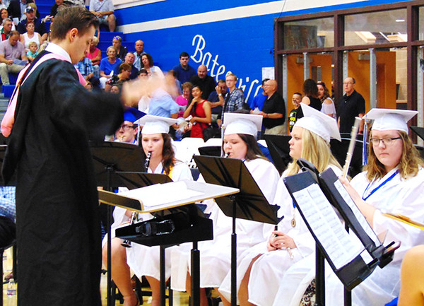 Debbie Blank | The Herald-Tribune<br /> Four senior musicians follow the conducting of band director Josiah Keith before they exited for commencement.