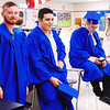 "Debbie Blank | The Herald-Tribune<br /> Ethan Gibbs (from left) felt jittery while Abram Garcia was nervous before the ceremony, realizing ""12 years add up to this."" Garcia will enlist in the National Guard, then attend technical school for collision repair, figuring his future is secure as long as there are cars. With them is Lain Goewert."