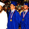 Debbie Blank | The Herald-Tribune<br /> After military-bound class members (from left) Gabriella Gibbs, Caleb Jenkins and Brice Keeton; and on the other side of the stage Nicholas Hampson, Caleb Raab and Faith-Anne Schrank led the Pledge of Allegiance, all remained standing as Batesville Singers presented the national anthem.