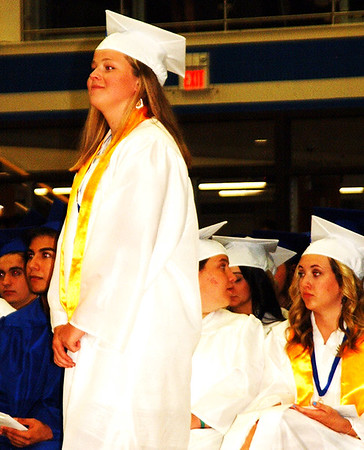 Debbie Blank | The Herald-Tribune<br /> Kate Poltrack prepares to receive her diploma.