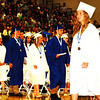 Debbie Blank | The Herald-Tribune<br /> Seniors wearing medallions have earned Indiana Core 40 Diplomas with academic or technical honors. Gold sashes denoted National Honor Society members and blue sashes indicated FFA distinguished members.