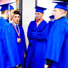 Debbie Blank | The Herald-Tribune<br /> Ready to get graduation done was the consensus of (from left) Dylan Holcomb, Caleb Jenkins, Johnathon Lynch and Alex Love as they wait in the hallway to enter the gym.