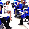 Debbie Blank | The Herald-Tribune<br /> Teagan Rork (from left), Faith-Anne Schrank, Elias Spurlock and Benjamin Rodgers relax in a classroom before lining up in alphabetical order to file into the gym Saturday morning, June 1.