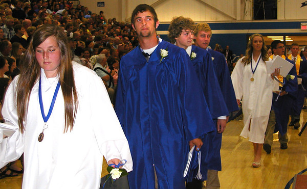 Debbie Blank | The Herald-Tribune<br /> DONE: The graduates collected their real diplomas in classrooms before meeting their families to celebrate.