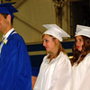 Debbie Blank | The Herald-Tribune<br /> THREE APPROACH THE STAGE to receive their diplomas.