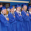 Debbie Blank | The Herald-Tribune<br /> A PROLONGED STANDING OVATION greeted seven male seniors entering the military. Caleb Abshear, Evan Bohlke, Curtis Davidson, Brandon Doyle, Maxwell Heidlage, Jared Laker and Dennis Vogt then led the crowd in the Pledge of Allegiance.