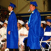 Debbie Blank | The Herald-Tribune<br /> IT DID NOT TAKE LONG for senior class President Trent Barnett to say the first, middle and last names of fellow students as they graduated.