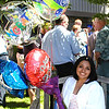 Debbie Blank | The Herald-Tribune<br /> FLOWERS AND BALLOONS help graduate Edith Saldana savor the moment.