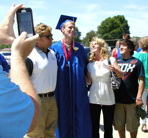 Debbie Blank | The Herald-Tribune<br /> SMART PHONES documented proud families congratulating their high school graduates.