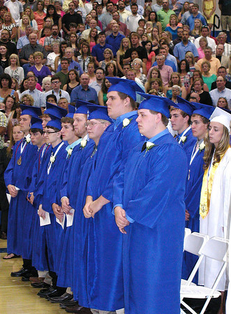 "Debbie Blank | The Herald-Tribune<br /> BHS SENIORS and spectators stood while Batesville Singers harmonized on ""The Star-Spangled Banner."""