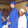 Will Fehlinger | The Herald-Tribune<br /> Students anxiously await to receive their diplomas.