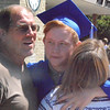 Will Fehlinger | The Herald-Tribune<br /> A graduate receives a congratulatory hug.