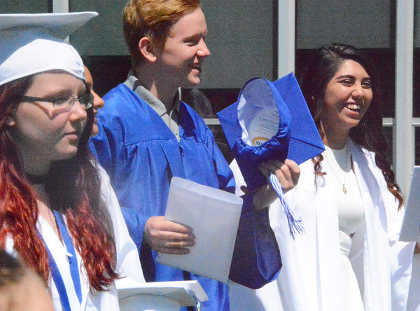 Will Fehlinger | The Herald-Tribune<br /> Graduates were ready to meet family and friends outside after the hour-long ceremony.