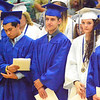 Will Fehlinger | The Herald-Tribune<br /> Graduates stand quietly after receiving their diplomas.