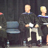 Will Fehlinger | The Herald-Tribune<br /> BHS principal Andy Allen (from left), superintendent Paul Ketchum and trustees Jeremy Raver, Cindy Blessing, Wanita Linkel, Dr. Stephen Stein and (not pictured) Ray Call wait on stage as the students process into the gym in their caps and gowns.
