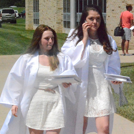 Will Fehlinger | The Herald-Tribune<br /> It didn't take long after the ceremony for grads to get their phones out.
