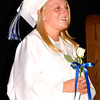Debbie Blank | The Herald-Tribune<br /> Madison Winters enters the gym carrying the class flower, a white rose.