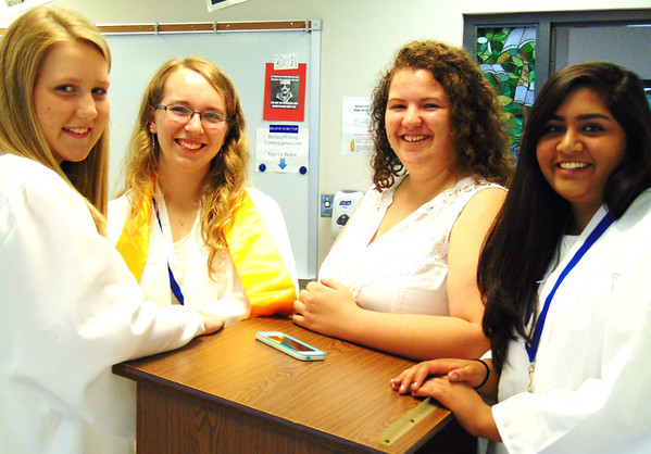 Debbie Blank | The Herald-Tribune<br /> Olivia Nobbe (from left), Samantha Nunlist, Leah Nordmeyer and Chandni Patel keep it light as they socialize in a classroom beforehand.