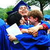 Debbie Blank | The Herald-Tribune<br /> After five friends posed for a serious caps and gowns photo on the school's front lawn, a mom asked for a joke photo. She received a shot of an exuberant Kevin Mateo hugging Ramon Romero (left) and Brandon Adams.