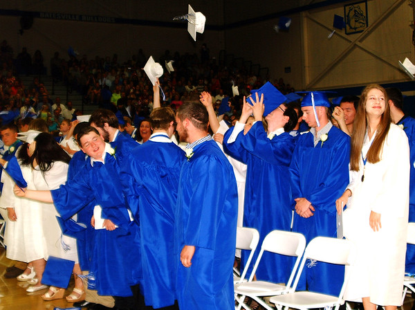 Debbie Blank | The Herald-Tribune<br /> It wouldn't be graduation without the traditional cap toss after tassels are turned.
