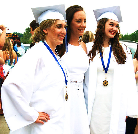 Debbie Blank | The Herald-Tribune<br /> Jenna Harmeyer (left) and Shelby Drew (right) are congratulated by friend Glycerine Bauman, who moved away from Batesville in seventh grade and will soon graduate from Maple Valley High School, Vermontville, Michigan.