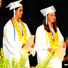 Debbie Blank | The Herald-Tribune<br /> Salutatorian Clare Bruns (left) and valedictorian Emily Weiler were presented with Paul and Thelma Grossman Scholarships by their son, John. The couple achieved the same ranks in the BHS Class of 1959.