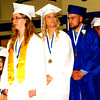 Debbie Blank | The Herald-Tribune<br /> Samantha Nunlist (from left), Morgan Oesterling and Patrick Ollier file up to the platform to receive their diplomas.