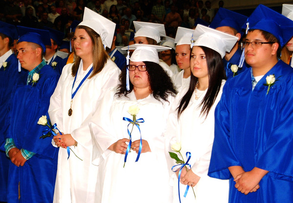 Debbie Blank | The Herald-Tribune<br /> Bulldogs (from left) Andrew Bane, Madison Ausenbaugh, Luna Arthur, Lacey Anderson and Bryson Amberger are solemn as the May 28 ceremony gets underway.