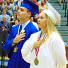 Debbie Blank | The Herald-Tribune<br /> Seniors Nathan Hall (left) and Destini Taylor-Fathman, preparing to enter the military, led the crowd in the Pledge of Allegiance at the beginning of commencement.