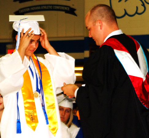 Debbie Blank | The Herald-Tribune<br /> Associate principal Justin Tucker presents Clare Bruns with a keepsake of her salutatorian achievement.