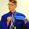 Debbie Blank | The Herald-Tribune<br /> Cody Roleson contemplates how he will get the cap to stay on his head.