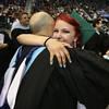 Billerica Memorial High School graduation. Jess Forrest hugs history and AP psychology teacher Mike Goddard after receiving her diploma. (SUN/Julia Malakie)