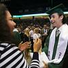 Billerica Memorial High School graduation. Graduate Josh Dempsey greets Parker School first grade teacher Lisa Maher after getting his diploma. (SUN/Julia Malakie)