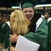 """Billerica Memorial High School graduation. Kevin Corkery hugs Parker Elementary School teacher Tina Leskouski, a teacher he thought he'd had, but hadn't. Leskouski said """"he's a cutie -- I'll give him a hug!"""" (SUN/Julia Malakie)"""